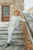 Outdoor fashion portrait of a cute little boy of 5 years old stock photos