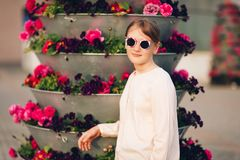 Outdoor fashion portrait of cute preteen girl. Portrait of cute little girl wearing vintage sunglasses, posing outdoors Royalty Free Stock Photo