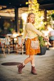 Outdoor fashion portrait of cute preteen girl. Wearing brown dress and yellow knitted jacket Stock Photos
