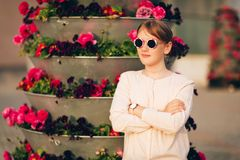 Outdoor fashion portrait of cute preteen girl. Portrait of cute little girl wearing vintage sunglasses, posing outdoors Stock Images