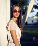 Outdoor fashion portrait glamor sensual young stylish woman in glasses, wearing a delicate summer dress outfit brunette Royalty Free Stock Image