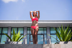Outdoor fashion portrait of glamour lady enjoying her vacation on luxury villa in hot tropical island, wearing stylish Stock Images