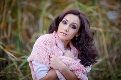 Outdoor fashion portrait of glamour sensual young stylish lady wearing trendy sweater Royalty Free Stock Photography