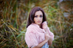 Outdoor fashion portrait of glamour sensual young stylish lady wearing trendy sweater Stock Image