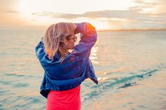 Outdoor fashion portrait of stylish girl wearing jeans jacket on the beach. stock image