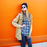 Outdoor fashion portrait of stylish hipster cool girl. Against a colorful urban wall royalty free stock images