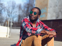 Outdoor fashion portrait of stylish young african man Stock Image