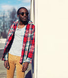 Outdoor fashion portrait of stylish young african man Stock Photos