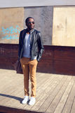 Outdoor fashion portrait of stylish young african man Stock Images