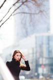 Outdoor fashion portrait of stylish young woman , emotional face ,  looking at camera. Urban city street style. Stock Images
