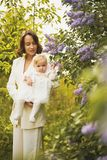 Mother and daughter in blossoming park stock images