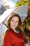 Outdoor fashion portrait of young beautiful sensual woman in Autumn park with umbrella Royalty Free Stock Image