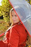 Outdoor fashion portrait of young beautiful sensual woman with umbrella Royalty Free Stock Photo