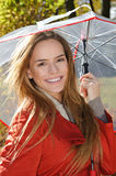 Outdoor fashion portrait of young beautiful sensual woman with umbrella Royalty Free Stock Photos