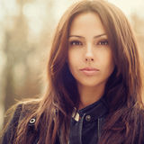 Outdoor fashion portrait of young beautiful woman - close up royalty free stock images