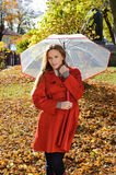 Outdoor fashion portrait of young beautiful woman with umbrella - Autumn in park Stock Image