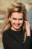 Outdoor fashion portrait of young blonde beautiful woman with bright make up Royalty Free Stock Photography