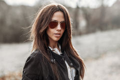 Outdoor fashion portrait of young pretty woman in sunglasses Royalty Free Stock Photo