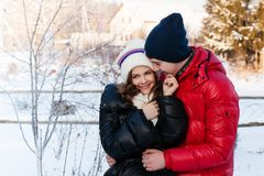 Outdoor fashion portrait of young sensual couple in cold winter wather. Love and kiss Stock Photos