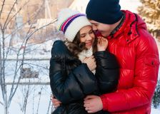 Outdoor fashion portrait of young sensual couple in cold winter wather. Royalty Free Stock Photos
