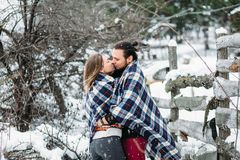 Outdoor fashion portrait of young sensual couple in cold winter weather. love and kiss. Outdoor fashion portrait of young sensual couple in cold winter wather Royalty Free Stock Photo