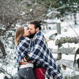 Outdoor fashion portrait of young sensual couple in cold winter weather. love and kiss. Outdoor fashion portrait of young sensual couple in cold winter wather Stock Photography