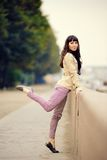 Outdoor fashion portrait of young sexy woman at embankment Stock Image