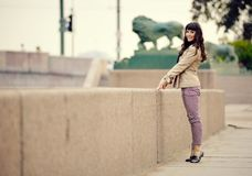 Outdoor fashion portrait of young sexy woman at embankment Royalty Free Stock Photo