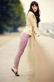 Outdoor fashion portrait of young sexy woman at embankment Royalty Free Stock Photography
