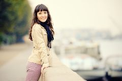 Outdoor fashion portrait of young woman at embankment Royalty Free Stock Photography