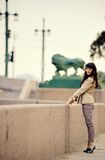 Outdoor fashion portrait of young woman at embankment Stock Photo