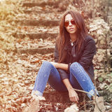 Outdoor fashion portrait of young sexy woman in jeans, jacket an Stock Image