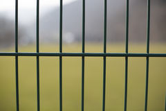 Outdoor fence in nature. Green metal fence building lines royalty free stock photography