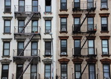Outdoor Fire Escapes on Two Contrast American Buildings Royalty Free Stock Photos