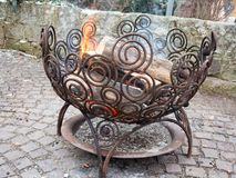 Outdoor fire place in an iron basket Stock Photos