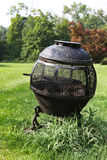 Outdoor fireplace. Located in backyard grass Stock Photography