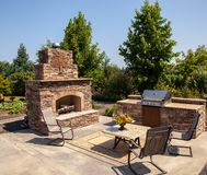 Outdoor fireplace and kitchen area Summer. A perfect spot for outdoor entertainment for the whole family