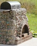 Outdoor fireplace from stone Royalty Free Stock Photo