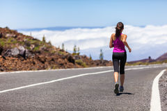 Outdoor fitness woman athlete runner road running royalty free stock photography