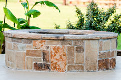 Outdoor flagstone firepit with landscape in background. Royalty Free Stock Image