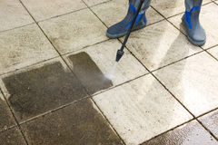 Outdoor floor cleaning with high pressure water jet Stock Photos