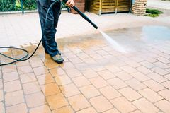 Free Outdoor Floor Cleaning With High Pressure Water Jet - Cleaning C Royalty Free Stock Photos - 125287038