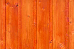 Outdoor floorboard. With orange color and knots Royalty Free Stock Images