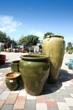 Outdoor Flower Pots. A photo of a group of green pots outside of a pottery store royalty free stock images