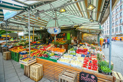 Outdoor food market in Munich. MUNICH, GERMANY - MAY 9, 2017 : People buying fruit and vegetable at the outdoor food market near Marienplatz in Munich, Germany Royalty Free Stock Image