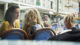 Outdoor food terrace family time mother boy and daughters. STRASBOURG, FRANCE - CIRCA 2018: Happy young beautiful mother at the outdoor cafe restaurant terrace stock video footage