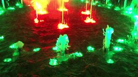 Outdoor fountain with colorful light display stock video footage
