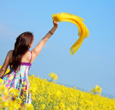 Outdoor freedom. Freedom, young woman with a shawl in rape field Stock Photography