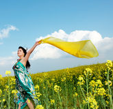 Outdoor freedom. Freedom, young woman with a shawl in rapeseed field Royalty Free Stock Photography