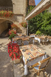 Outdoor French restaurant. In sunny southern France Stock Images
